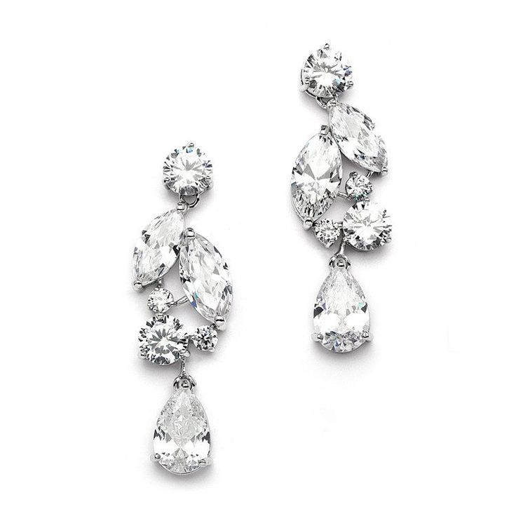 "Our glamorous 2"" h x 3/4"" w mosaic earrings blend marquise, round, and teardrop Cubic Zirconia to make a truly elegant statement for any bride. These rhodium silver plated earrings are also great for"