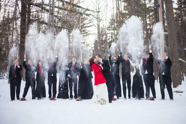 Have your bridal party toss handfuls of snow as you share a kiss!