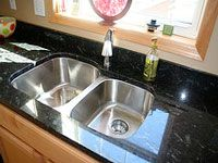 Mix one part rubbing alcohol with three parts water and a few drops of ph-neutral dishsoap. Apply this solution to your granite with a spray bottle, then wipe with a soft cloth.
