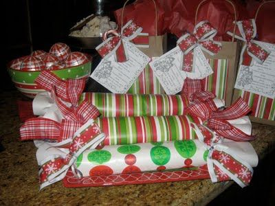 Make your own holiday gifts with kids. Inside these cutely decorated packages are frozen cookie dough rolls (and the recipe). Who doesn't like cookie dough? The idea behind this gift is… the recipient can eat the gift as is (cookie dough) or can bake it when they feel like having fresh baked cookies!