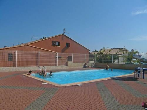 """Holiday home Hacienda Gruissan Gruissan Residence """"L'Hacienda"""" is situated in the district of Ayguades, 3 km from the centre of Gruissan and 800 m from the sea. For shared use there is a swimming pool (12 x 5 m, depth 90 - 180 cm, 18.06.-01.09.). Parking space is available."""