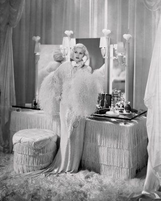 Jean Harlow at her fringe and feather-festooned dressing table in Dinner At Eight (1933).