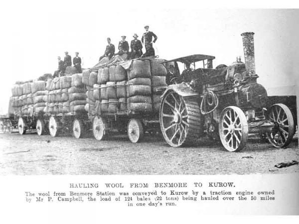 The wool clip from Benmore station being conveyed to Kurow by Mr P Campbell's traction engine and wagons. The load of 124 bales, weighing 22 tons, was hauled over the 50 mile journey in one day's run. Otago Witness, 9.2.1910.