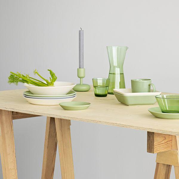 Nappula candleholder and Teema tableware in celadon green by Iittala.