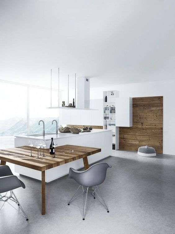 cucine in stile minimal isola con tavolo integrato