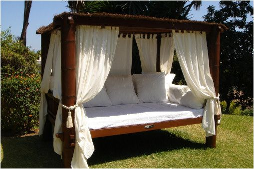 I have a thing for day beds they are a must for a backyard with lots of cushions and underneath lush trees