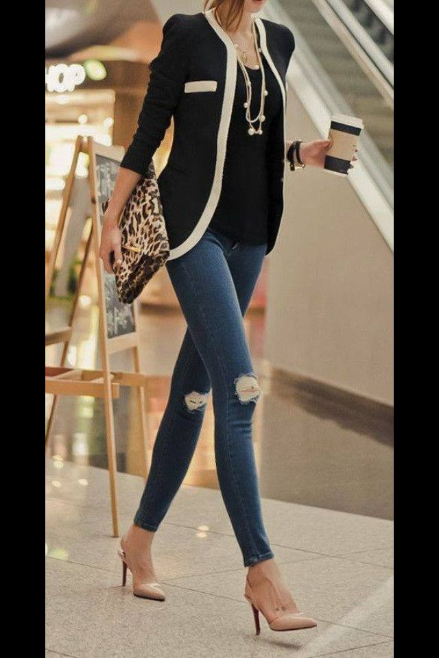 Cute pangs and heels balance out the conservative sweater