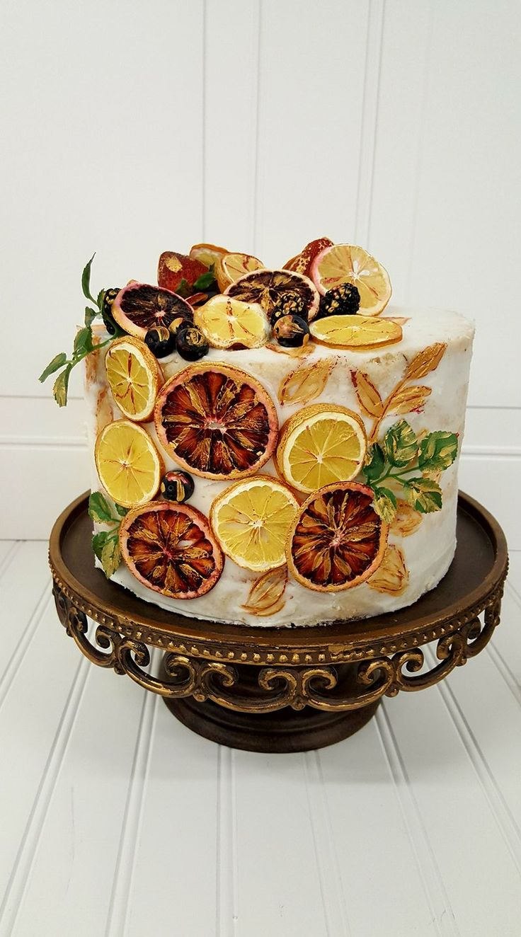 Semi-Naked Cake with dehydrated fruit, blood oranges, lemons, blueberries, blackberries, strawberries, hand painted.  by Love Is In The Air Events. www.loveisintheairevents.comLove Is In The Air