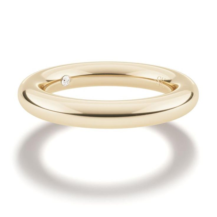 A modestly priced Spinelli Kilcollin wedding band in yellow gold, with a hidden white diamond. The wedding jewellery designer creating jewelry for both men and women on the big day in the most unusual and alternative ways: http://www.thejewelleryeditor.com/bridal/interview/spinelli-kilcollin-alternative-wedding-collection-cool-engagement-rings/ #jewelry