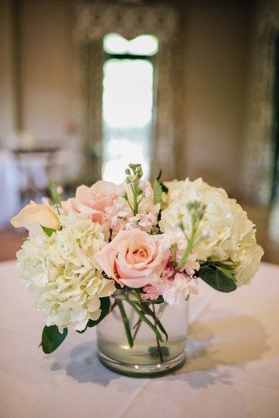 Simple wedding centerpiece idea white hydrangeas and