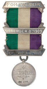 "A suffragette pin ""For Valour - Hunger Strike - September 7 1909 - December 8 1909"" Besides being a three month strike (!), that really was brave because suffragettes were sometimes imprisoned and tortured by being forcibly fed through tubes down their nose if they refused to open their mouths."
