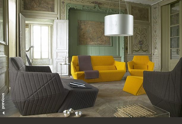 An artistic living room with grey and yellow sofas.. interesting mix of styles here