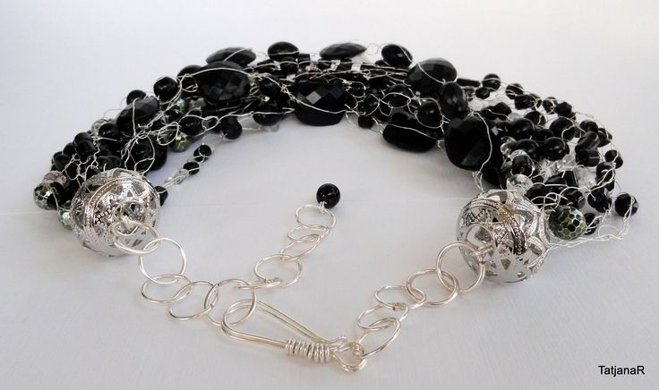 Necklace crochet with silver pleated cooper wire and black beads.