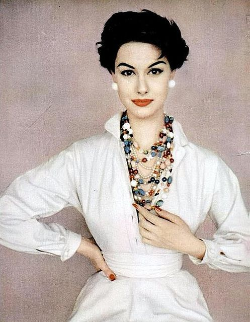 "Nancy Berg is wearing white Claire McCardell dress with two strands of ""homemade"" beads, photo by Francesco Scavullo, 1954"