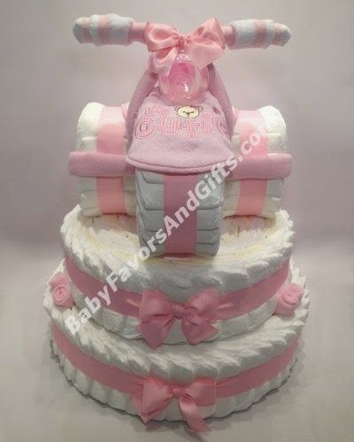 Pink tricycle diaper cake
