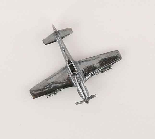 P-51 pendant in oxidized silver.