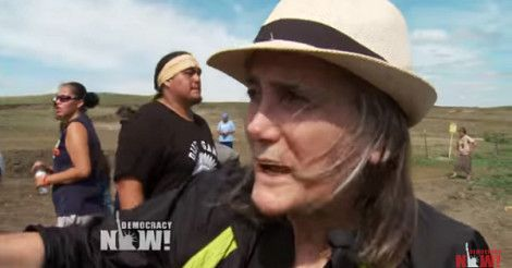 Amy Goodman reporting on the Dakota Access Pipeline. (image: Democracy Now!) North Dakota State's Attorney Ladd Erickson has dropped criminal trespassing charges against Democracy Now!'s Amy Goodman—and is instead seeking to charge her with participating in a riot, Democracy Now! (10/15/16) reported today. Both sets of charges relate to Goodman's coverage of protests against the […