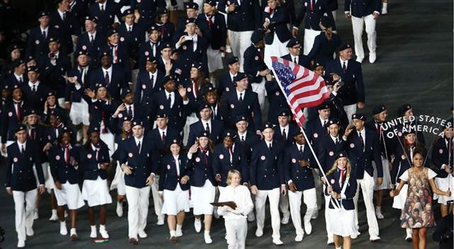 .Members of the contingent from the U.S. take part in the athletes parade during the opening ceremony of the London 2012 Olympic Games at the Olympic Stadium July 27, 2012.