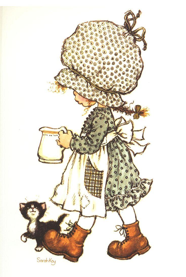 Sarah amenant du lait au petit chat