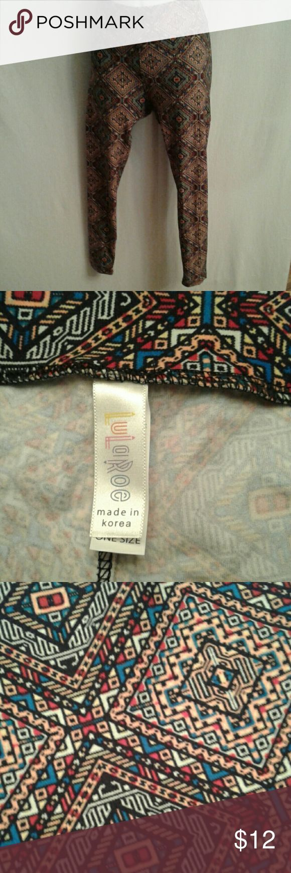 "LuLaRoe aztec print leggings sz S Aztec print leggings in EUC. The print is concentric diamonds in black, red, blue, white and  coral. It is 92/8 polyester/spandex blend, machine wash and dry. Unstretched, the cummberbund waist measures 12 1/2"", the inseam is 24 1/2"", unstretched, and the front drop is 10 -/2"" and the back drop is 13"".  The waistband could also be folded over for a different look. LuLaRoe Pants Leggings"