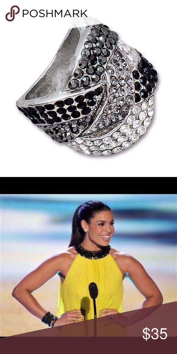 NWOT Lia Sophia Cocktail Hour Ring NWOT Lia Sophia Cocktail Hour Ring! Size 5. As seen on Jordin Sparks. This gorgeous oversized ring features clear, smoky and black sparkly cut crystals in silvertone setting. Brand and ring size engraved inside the ring, see photo. Lia Sophia Jewelry Rings