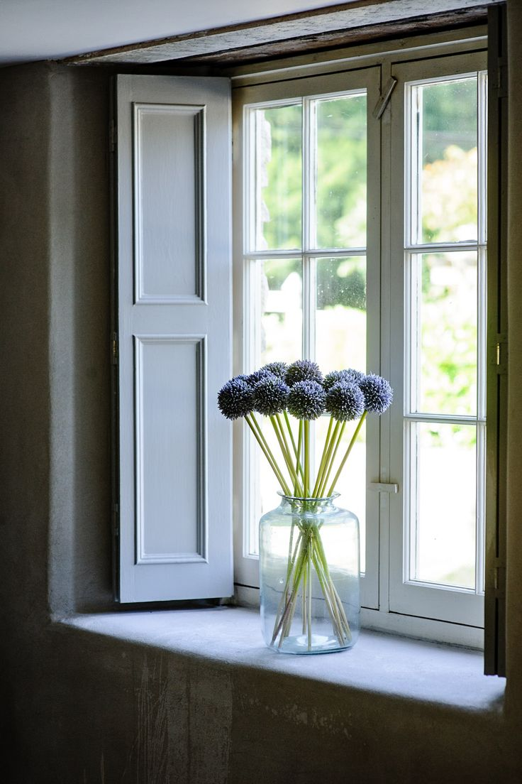 Large Cottage Window With Pale Wooden Shutters.To Top It Of A Clear Large  Vase