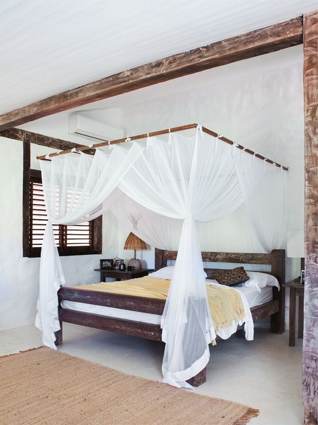 Rustic House in Bahia, Brazil. canopy over tufted headboard?