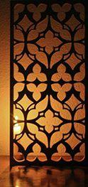 Barnizados_Garcia_e_Hijos_Decoración_02Paneles de madera perforados y con relieves de formas orgánicas, curvas y geométricas. Perforated wooden panels embossed with organic curves and geometric shapes.