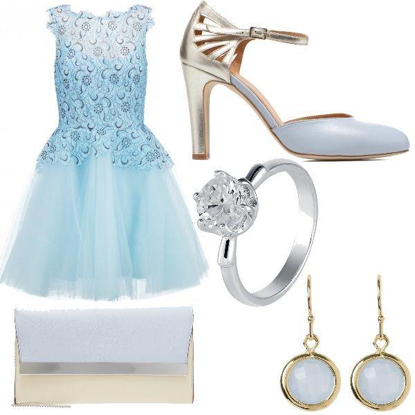 Outfit fiabesco caratterizzato da colori che ricordano Cinderella ed è composto da abito con corpetto ricamato e gonna in tulle celeste, scarpe allacciate al collo con punta celeste e tacco dorato, pochette bicolore, orecchini e anello con pietra simil cristallo.