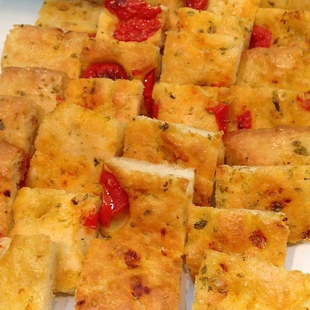 Who is in for a piece of focaccia from Puglia? Thanks @atasteoftravel for your nice shot! #WTM13 #WeAreinPuglia