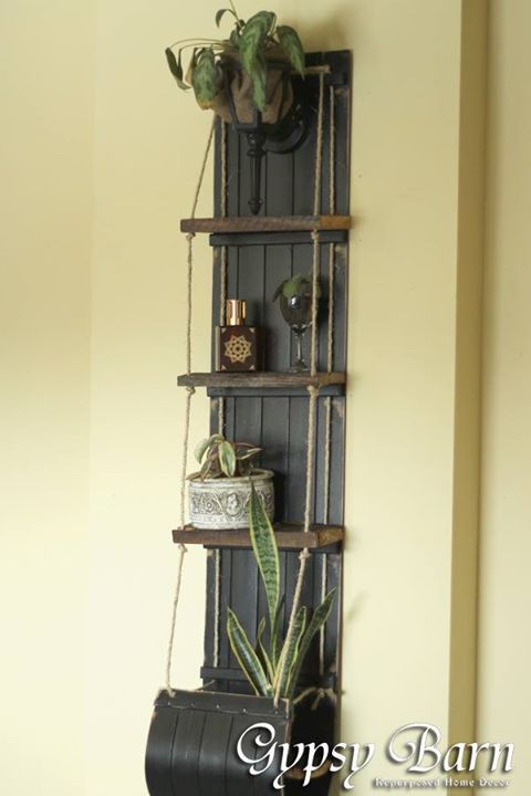 Gypsy Barn - Repurposed toboggan into shelf....like the addition of wood shelf and rope
