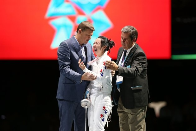 JULY 30: A Lam Shin of Korea gets escorted off stage after a faulty clock ended her match against Britta Heidemann of Germany in the Women's Epee Individual Fencing Semifinals on Day 3 of the London 2012 Olympic Games at ExCeL on July 30, 2012 in London, England. Heidemann scored the final point with one second left on the clock to win against Shin. (Photo by Ezra Shaw/Getty Images)