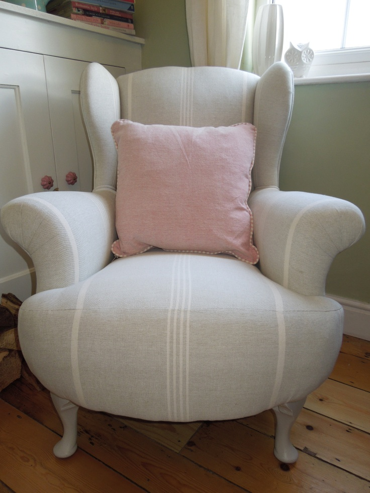 We'd love to cosy up on this comfy vintage armchair, reupholstered in Susie Watson Design's fabric