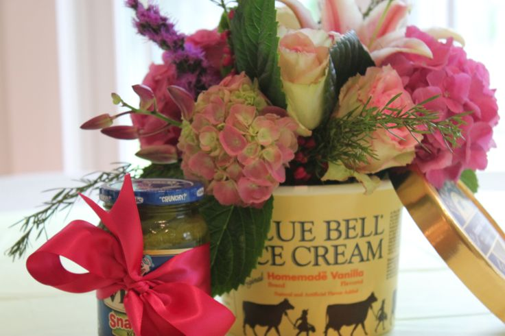 This was from a Pickles & Ice cream baby shower but I like the idea of using an ice cream container for flowers for an ice-cream social.