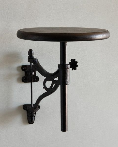 Avery Wall Shelf It's fashioned after an old train conductor's seat. Could also use an old piano stool??