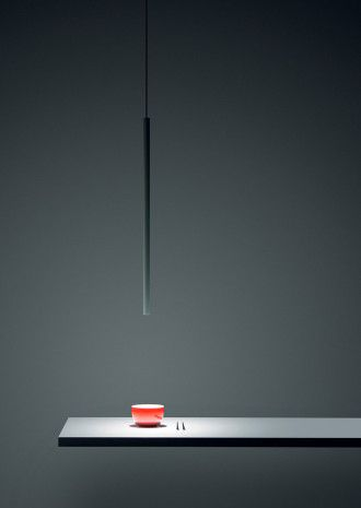 One of my favorite lamp.<br /> Designed by Omar Carraglia in 2006. So much slim and essential ...<br /> Its light on the table is marvelous. The best light in the world.