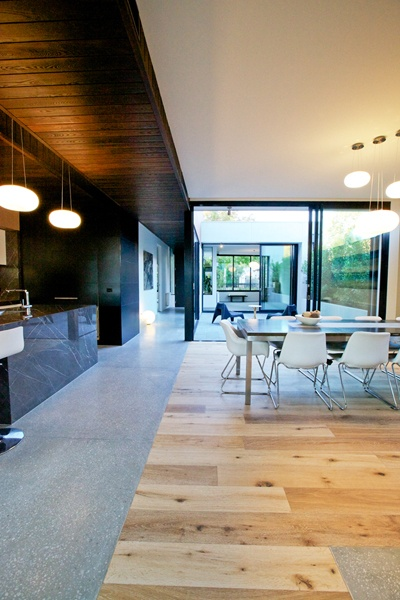 Transition & contrast from timber ceiling to white