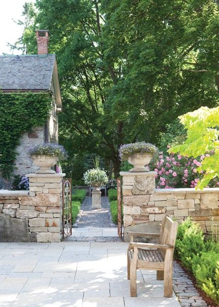 Rustic Country Pathway    Stone elements and lush plants give a garden an old-world quality.      Section off your backyard into separate areas by creating a low-level stone wall complete with an aged garden gate. Place planters atop pillars for added height. For continuity, frame the pathway extending past the gate with the same stone used in the enclosed area.