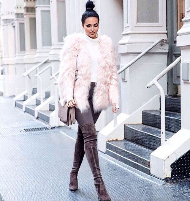 Blush pink fur jacket and thigh high boots.