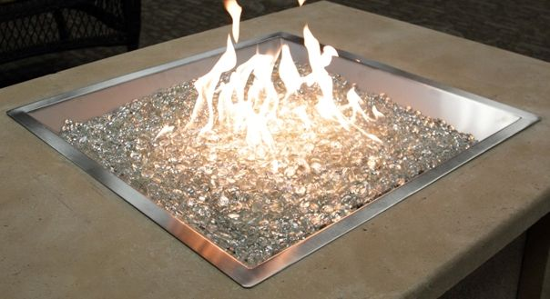 Glass Fire Pit--similar to our pit and I have fire glass in our fire place too...so beautiful!!