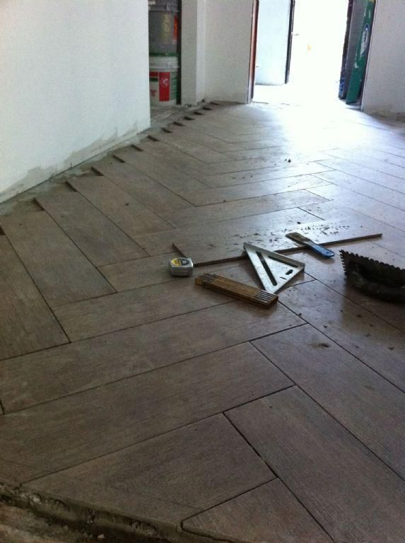herringbone tile design - with porcelain tile that looks like wood.  Very cool