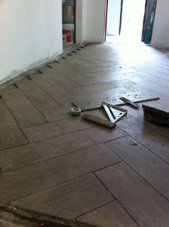 herringbone tile design - with porcelain tile that looks like wood.  Very cool