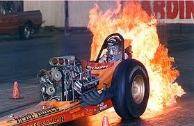 """Tony """"The Loner"""" Nancy's Top Fuel dragster doing a crowd pleasing fire burnout."""