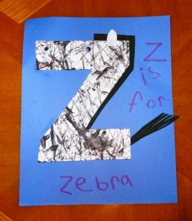 Z is for zebra. Cut-out z taped onto a tray.  Black paint dots around it and marbles used as paint brushes. Kids tilt tray back n forth until satisfied with their zebra strips.
