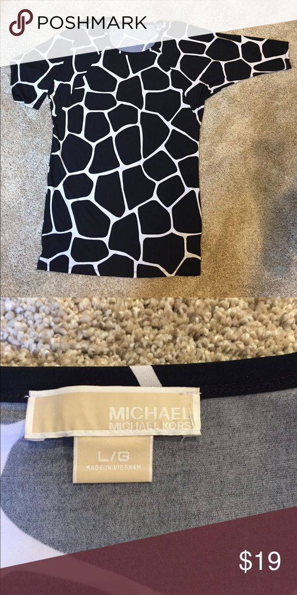 Michael Kors black white funky fun dress Size large Michael Kors black white dress. Fun style on its own or over leggings ! 95% Polyester and 5% spandex doesn't wrinkle so great for travel Michael Kors Dresses