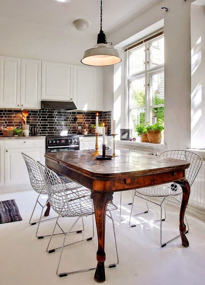contemporary kitchen with antique table and modern