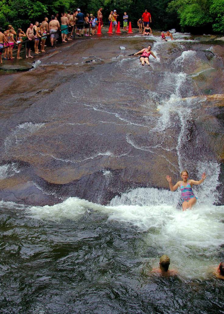 Sliding Rock - fun, warm-weather seasonal attraction along scenic US 276 in Pisgah National Forest near Asheville, NC. Accessed from either the nearby town of Brevard, or from Asheville south on the Blue Ridge Parkway, then south on US 276, where you also find the additional attractions of the Cradle of Forestry and Looking Glass Falls.