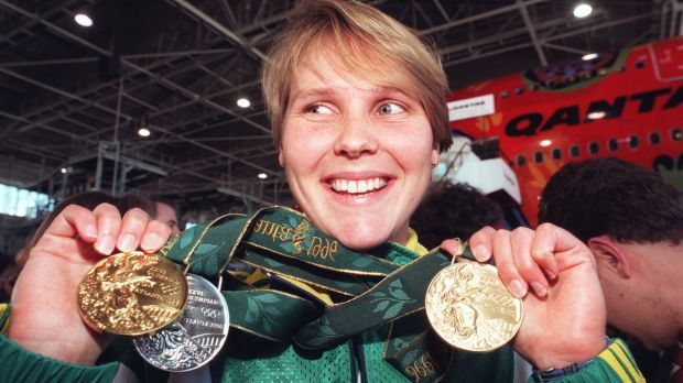 Australian swimmer Susie O'Neill shows off her medals from the Atlanta Olympics