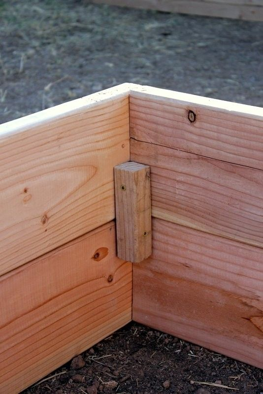 "How to Build Raised Garden Boxes - use 2x2"" wood to brace the corners of the boxes - and place it lower than the height of the box so dirt will cover it."