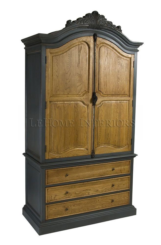 """Шкаф Chambre Antique Armoire. Гардероб в викторианском стиле. Уникальностью данного шкафа можно назвать массивность и основательность конструкции, с подчеркнутой вертикальностью (стремлением ввысь) всех элементов. Ручная работа, каркас изготовлен из массива березы, дверцы из массива дуба. Тонировка с эффектом потертостей и """"старения""""."""